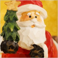 santa_claus_and_christmas_tree_207602