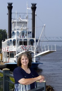 Stoddard, Wis. author Pat Middleton poses in front of the riverboat the Julia Belle Swain on the river front in La Crosse, Wis. Erik Daily
