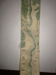 long detail of authentic ribbon map, Janice Chabot This is the most ambitious Coloney & Fairchild strip or ribbon map: it shows the Mississippi River from its delta to its source at Lake Itaska, a distance of 2600 miles. It is backed on linen and rolls into paper covered spool with a hand crank. This is the revised edition, with much additional material added on river towns by William Bowen, President of the Pilot's Association of St. Louis (this information comes from the promotion for this map printed on the Ribbon Map of New York City). No record of the first issue found, although a copy exists at the Minnesota Historical Society. The river is colored blue against a black and white background. Distances from New Orleans are printed on the river at intervals to the source. Karrow's listing is for a variant: the map printed in five strips on one sheet and folded into the 1866 edition of Edward's Gazetteer of the Mississippi River. Scarce. Reference : cf Karrow 1-0304. Region : Mississippi River Subject : Rivers Full Title : Coloney & Fairchild's Patent Ribbon Maps ... Ribbon Map Of The Father Of Waters. Geographical and Scenic Maps upon this plan of all the rivers, rail road routes, stage and coast lines in the country are in preparation. List No : 4995.001 Series No : 2 Publication Author : Coloney, Fairchild & Co. Pub Date : 1866 Pub Title : Coloney & Fairchild's Patent Ribbon Maps ... Ribbon Map Of The Father Of Waters. Geographical and Scenic Maps upon this plan of all the rivers, rail road routes, stage and coast lines in the country are in preparation. Pub Reference : cf Karrow 1-0304. Pub Note : See note field above. Pub List No : 4995.000 Pub Type : Separate Map Pub Maps : 1 Pub Height cm : 7 Pub Width cm : 333 Image No : 4995001 Download 1 : Full Image Download… Download 2 : MrSID Image Vi
