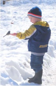 child with chickadee winter